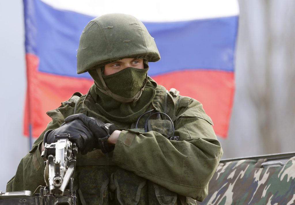 """One of Vladimir Putin's """"Little Green Men"""" (Russian soldiers without identifying insignia) pictured during the Kremlin seizure of Ukraine's Crimean peninsula in 2014. (REUTERS/Vasily Fedosenko)"""