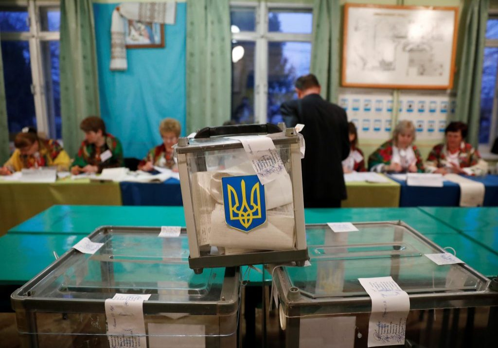 Ukrainians go to the polls on October 25 to vote in local elections that promise to serve as the first major electoral test for President Zelenskyy since he and his party swept to power last year. (REUTERS/Kacper Pempel)