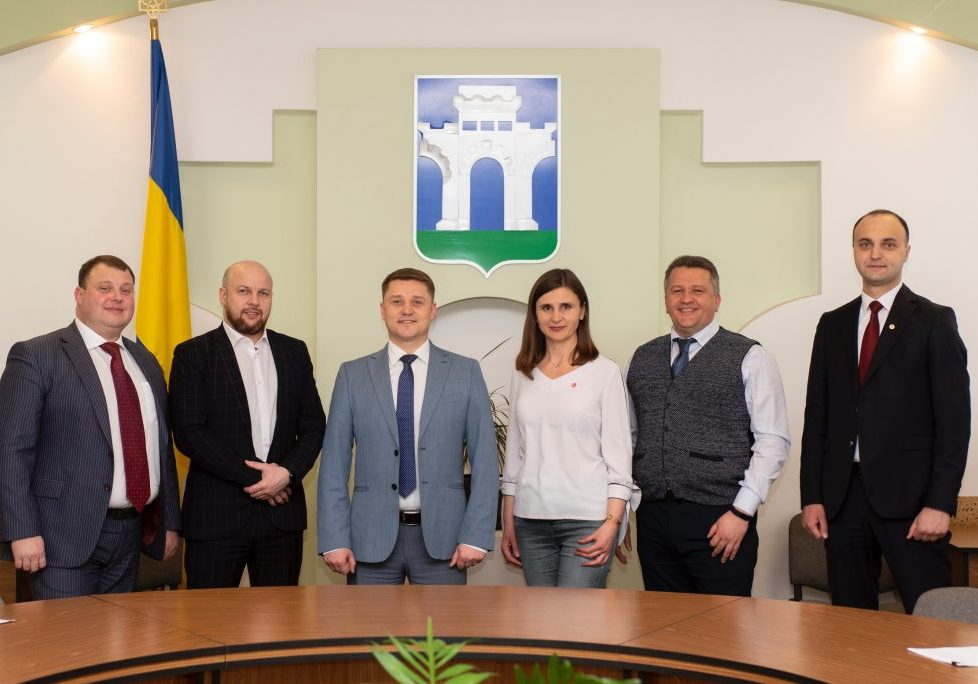 34-year-old Rivne Mayor Oleksandr Tretyak (pictured, center, with members of his municipal team) was elected in late 2020 in a vote that reflected a strong local appetite for political change in the western Ukrainian city.